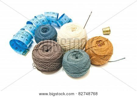 Balls Of Yarn And Thimble On White