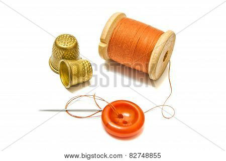 Spool Of Orange Thread, And Thimbles