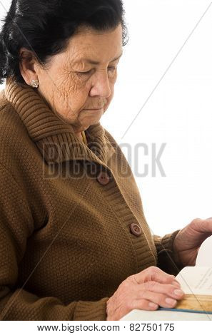 portrait of beautiful grandmother reading a book