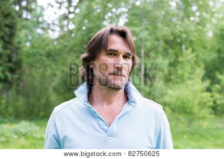 Man With A Stubble In The Summer Park