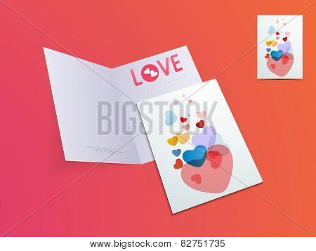 Elegant open greeting card with colorful hearts for Happy Valentines Day celebration on glossy colorful background.