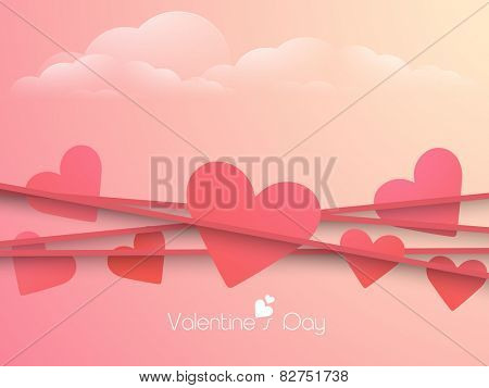 Happy Valentine's Day celebration with pink hearts on colorful cloudy background.