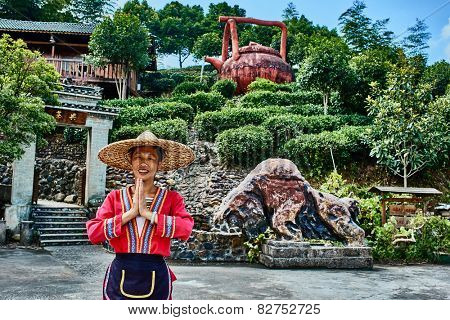 Guangxi, China - September 29, 2014 :Chinese woman in front of traditional tea house  between Guilin and Yangshuo in Guangxi province  China