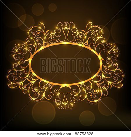 Beautiful floral design decorated shiny frame in golden color on brown background.