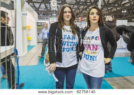 Girls Wearing Expo T-shirt At Bit 2015, International Tourism Exchange In Milan, Italy