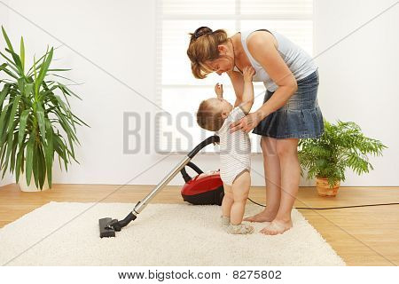 Mother Cleaning The Floor