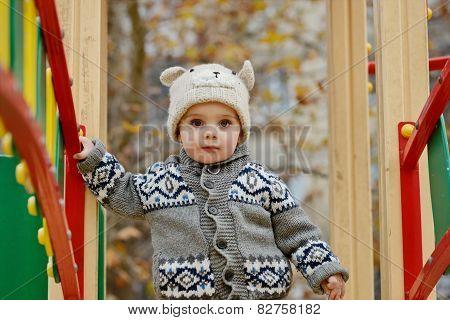 Boy Walking On Playground