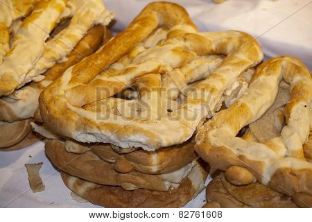Group Of Salted Pretzels On Market Stall