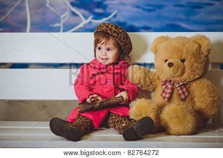 Cute funny baby girl with toy bear