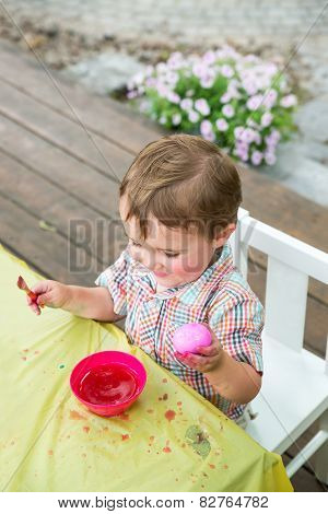 Happy Boy Holding A Pink Dyed Easter Egg