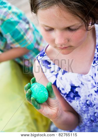 Girl Holds Her Dyed Green Easter Egg
