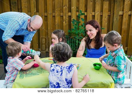 Family Painting Easter Eggs