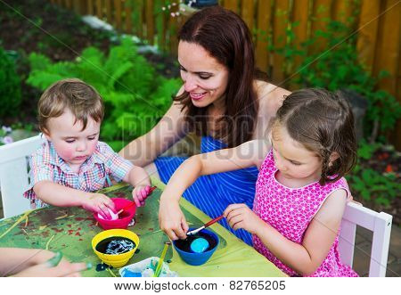 Little Boy Dyeing An Easter Egg Pink