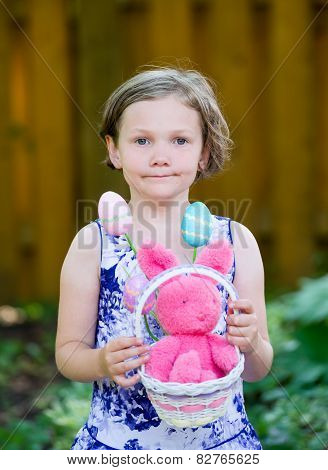 Girl Holding An Easter Basket With Bunny