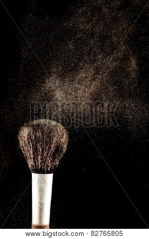 Brush and a powder spread out