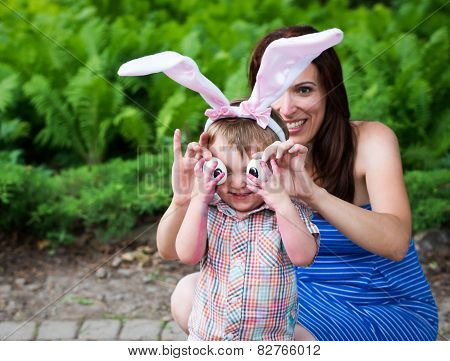 Little Boy Wearing Bunny Ears And Silly Egg Eyes - Close Up
