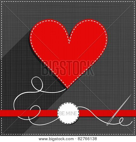 red heart sewed romantic Valentines Day card on gray with ribbon and badge