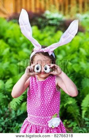 Little Girl Wearing Bunny Ears And Silly Egg Eyes