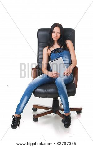 Woman using a touch-pad PC sitting in chair