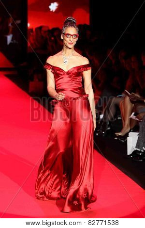 NEW YORK-FEB 12: Chef Carla Hall wears Evgenia at Go Red for Women - The Heart Truth Red Dress Collection during Mercedes-Benz Fashion Week at Lincoln Center on February 12, 2015 in New York City.