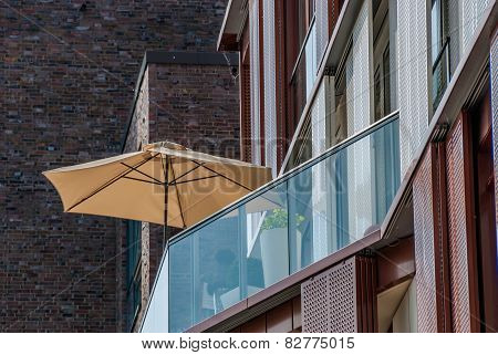 Beach umbrella on an apartment patio Hamburg Germany