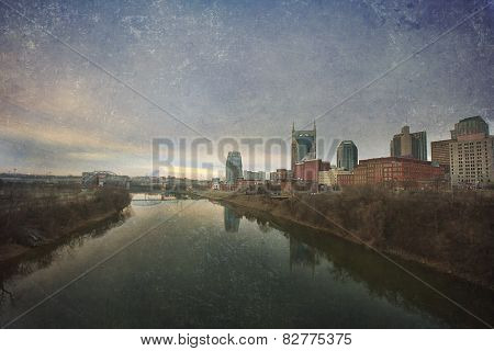Nashville, Tennessee skyline at sunrise.  This image has an artistic texture overlay for a fine art, vintage feel.