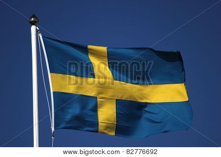 Swedish Flag On Dark Blue Sky