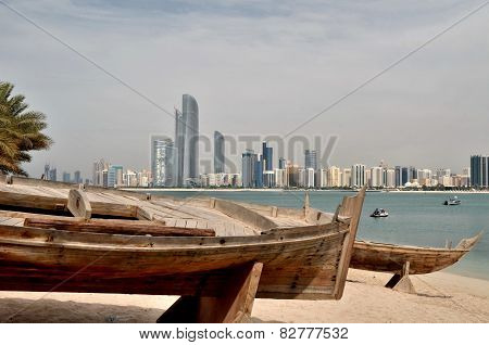 Old Boat On The Background Of Skyscrapers In Abu Dhabi, United Arab Emirates