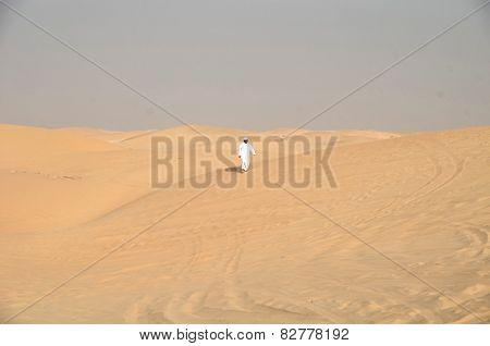 Local Resident Walking Through The Desert Dubai; Uae
