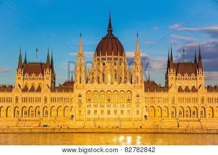 Budapest Parliament Building Illuminated During Sunset With Danube River, Hungary, Europe