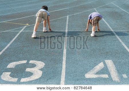 Two Boys Run On Track