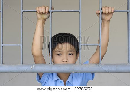 Boy Sad Behind The Iron Bar