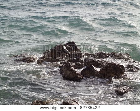 Waves and stones