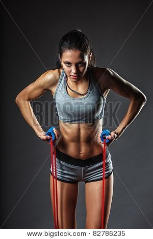 woman exercising with rubber tape