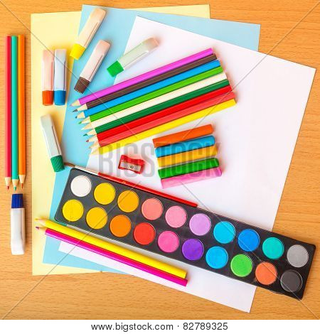 Colorful art supplies on a school desk