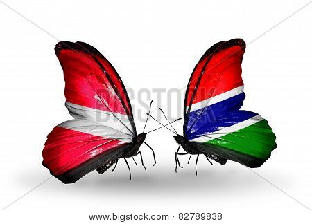 Two Butterflies With Flags On Wings As Symbol Of Relations Latvia And Gambia