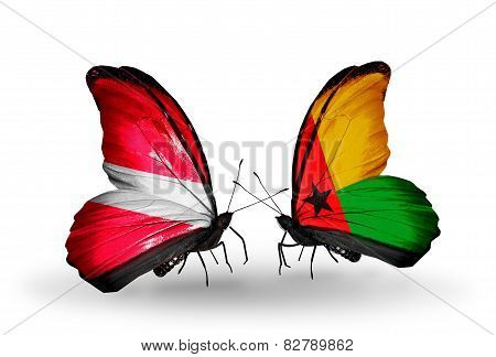 Two Butterflies With Flags On Wings As Symbol Of Relations Latvia And Guinea Bissau