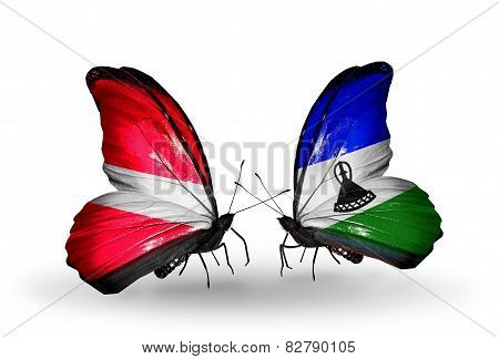 Two Butterflies With Flags On Wings As Symbol Of Relations Latvia And Lesotho