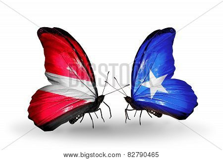 Two Butterflies With Flags On Wings As Symbol Of Relations Latvia And Somalia