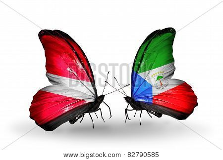 Two Butterflies With Flags On Wings As Symbol Of Relations Latvia And Equatorial Guinea