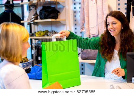 Young Woman In The Clothes Shop