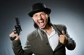 image of cap gun  - Man with gun and vintage hat - JPG
