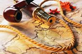 stock photo of spyglass  - Marine still life with world map and spyglass on wooden table background - JPG