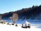 stock photo of gazebo  - Gazebo by the river in the winter in sunny weather - JPG