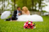image of married couple  - Wedding couple and flower bouquet on a wedding day - JPG