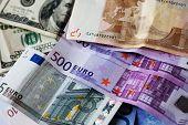 stock photo of depreciation  - dollar and euro notes - JPG