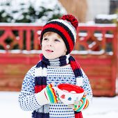 picture of cold drink  - Little boy drinking chocolate drink with marshmallows outdoors with snow background - JPG