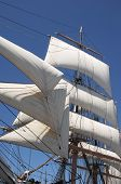 image of tall ship  - white billowing sails from a vintage tall ship - JPG