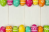 foto of egg whites  - Colorful Easter egg frame against a white wood background - JPG