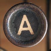 stock photo of old vintage typewriter  - Details of a dusty old letter closeup of vintage typewriter - JPG